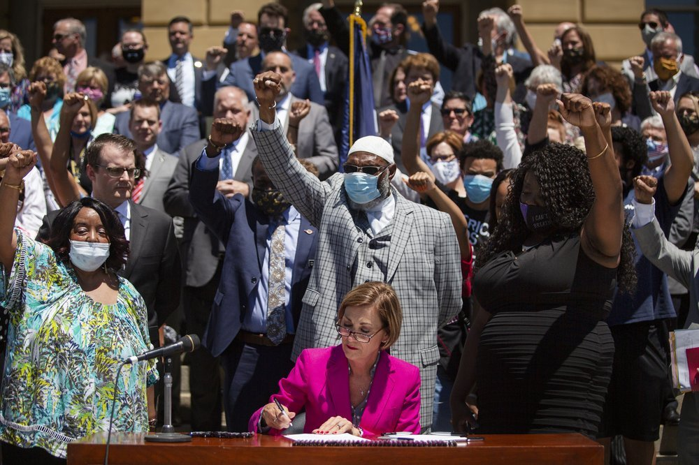 Governor Reynolds Signs Police Reform Bill into Law 11